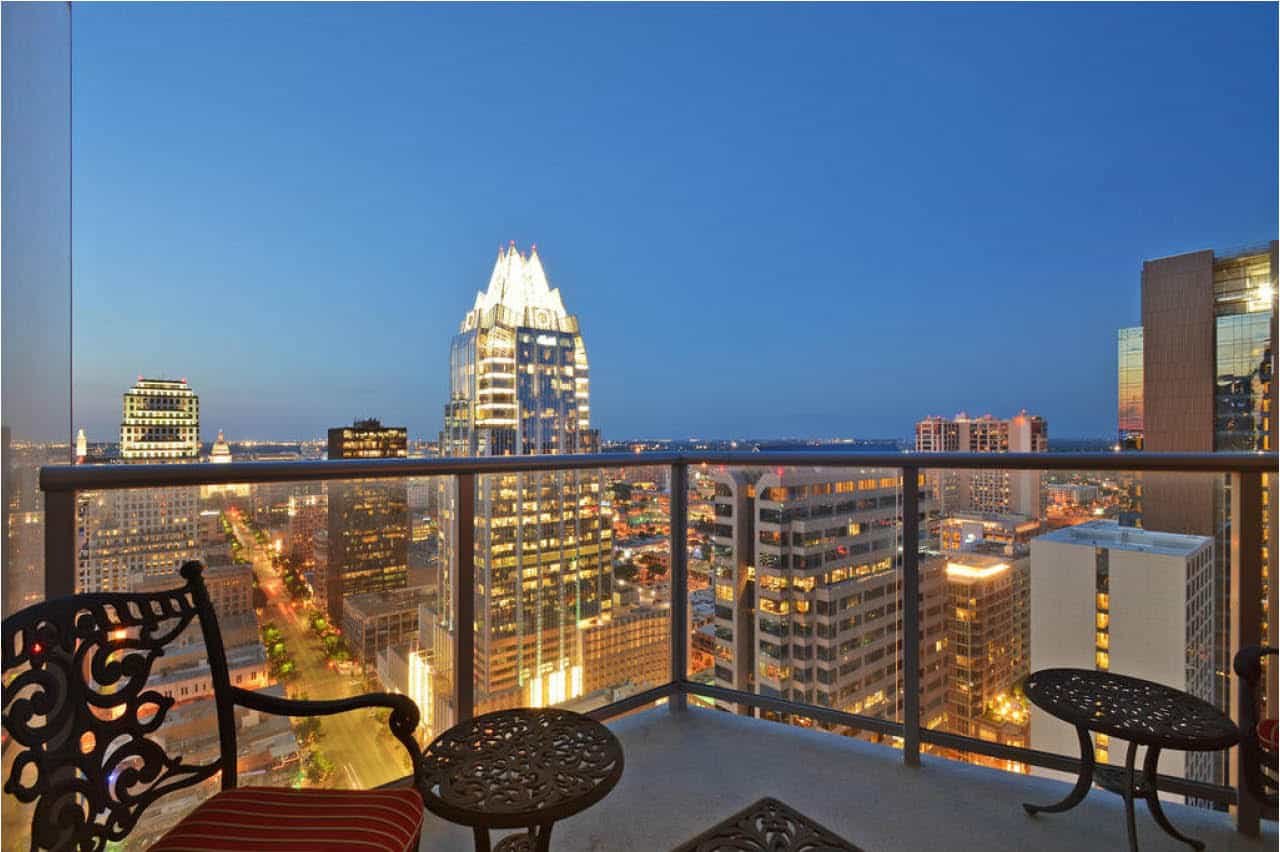 balcony view nightlife austin skyline frost building